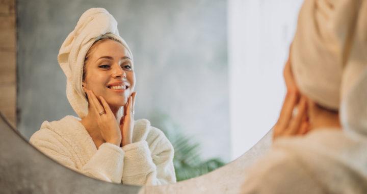 Woman at home applying cream mask